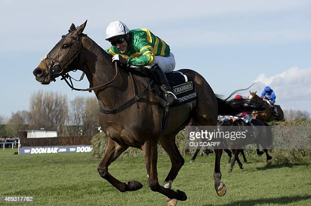 Jockey AP McCoy riding horse 'Shutthefrontdoor' crosses the final fence to finish in fifth place in the Grand National horse race on the final day of...