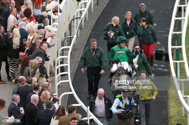 Jockey Barry Geraghty celebrates victory on Ma Filleule in the Crabbie's Supporting Everton In The Community Topham Chase