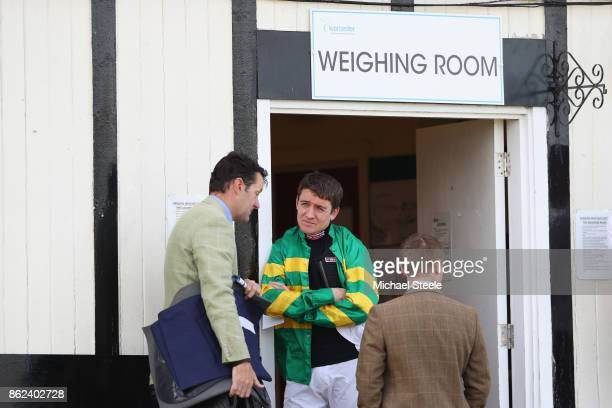 Jockey Barry Geraghty in discussion ahead of racing at Worcester Racecourse on October 17 2017 in Worcester England