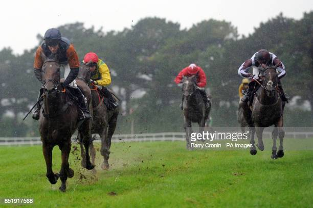 Jockey Barry Geraghty rides Rebel Fitz to victory in the Guinness MidStrength Novice Steeplechase during day four of the 2013 Galway Summer Festival...
