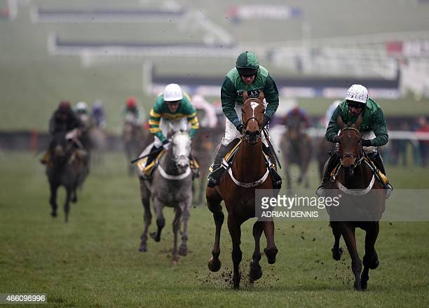 Jockey Barry Geraghty riding Peace and Co on his way to winning the JCB Triumph Hurdle Race on the final day of the Cheltenham Festival horse racing...