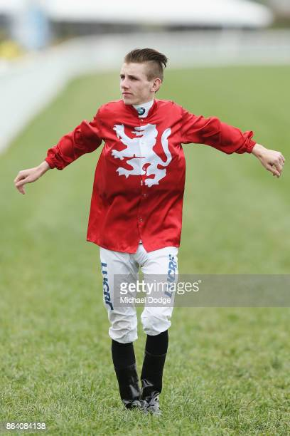 Jockey Beau Mertens stretches during Melbourne Racing at on October 21 2017 in Melbourne Australia