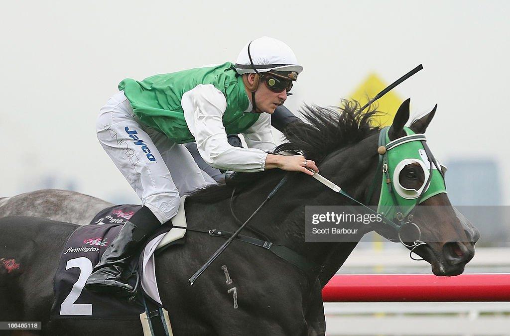 Jockey Ben Knobel riding Banca Mo wins race 6 National Jockeys' Trust Handicap during Melbourne Racing at Flemington Racecourse on April 13, 2013 in Melbourne, Australia.