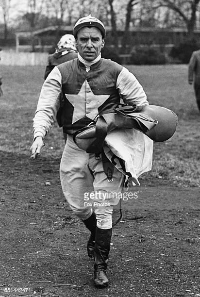 Jockey Charlie Elliott carrying his saddle ready to rise at Kempton Park England April 5th 1947