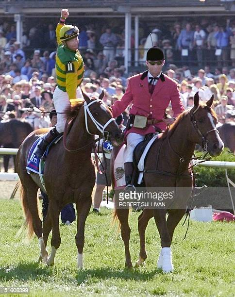 Jockey Chris Antley aboard Kentucky Derby winner Charismatic celebrates after winning the 125th Kentucky Derby 01 May 1999 at Churchill Downs in...