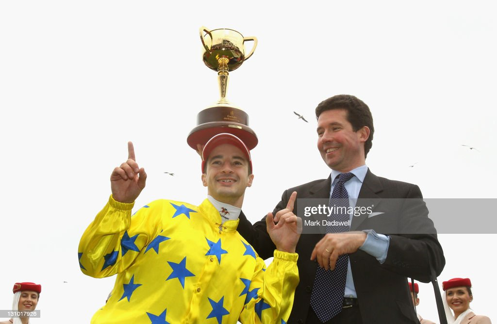 Jockey Christophe Lemaire and trainer Mikel Delzangles celebrate with the trophy after Dunaden won the 2011 Emirates Melbourne Cup during Melbourne Cup Day at Flemington Racecourse on November 1, 2011 in Melbourne, Australia.