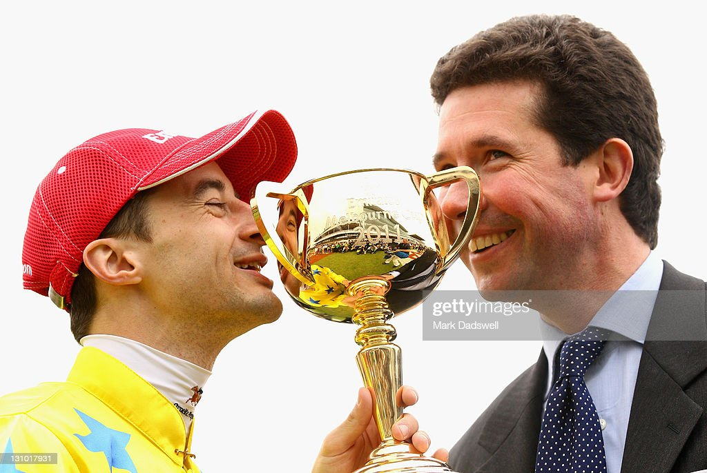 Jockey Christophe Lemaire and trainer Mikel Delzangles kiss the trophy after Dunaden won the 2011 Emirates Melbourne Cup during Melbourne Cup Day at Flemington Racecourse on November 1, 2011 in Melbourne, Australia.