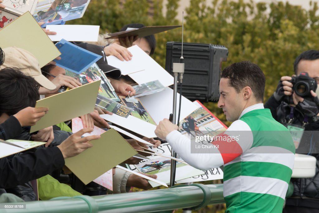 Jockey Christophe Lemaire gives his autograph to Japanese racing fans at Nakayama Racecourse on March 6, 2016 in Funabashi, Chiba, Japan.