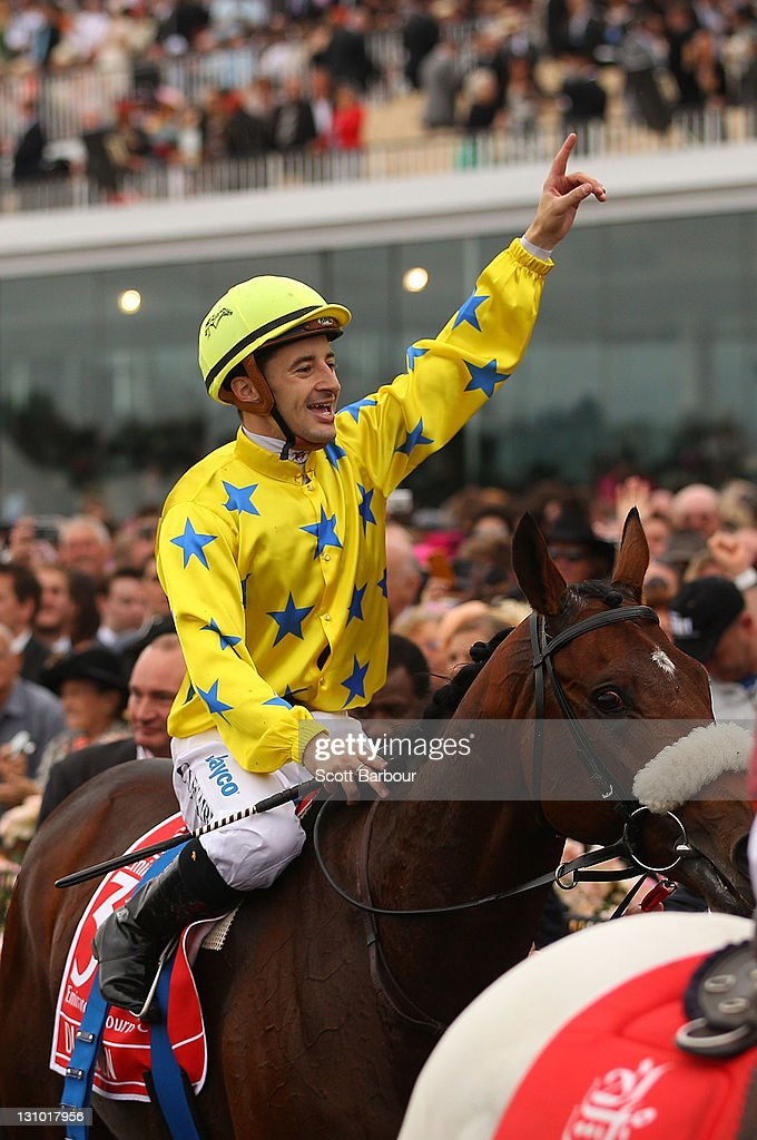 Jockey Christophe Lemaire riding Dunaden celebrates after winning Race 7 the Emirates Melbourne Cup during Melbourne Cup Day at Flemington Racecourse on November 1, 2011 in Melbourne, Australia.