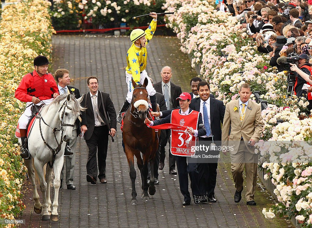 Jockey Christophe Lemaire riding Dunaden celebrates as he returns to scale after winning the 2011 Emirates Melbourne Cup during Melbourne Cup Day at Flemington Racecourse on November 1, 2011 in Melbourne, Australia.
