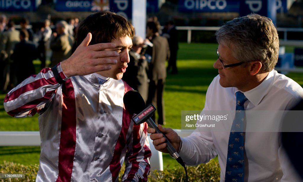 Jockey <a gi-track='captionPersonalityLinkClicked' href=/galleries/search?phrase=Christophe+Soumillon&family=editorial&specificpeople=453308 ng-click='$event.stopPropagation()'>Christophe Soumillon</a> angrily chats with ATR's Mike Cattermole after being given a five day ban for a whipping offence and losing over £55,000 in prize money after riding Cirrus Des Aigles to win The Qipco Champion Stakes at Ascot racecourse on October 15, 2011 in Ascot, England.