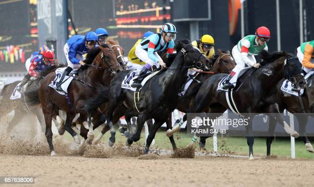 Jockey Christophe Soumillon rides Thunder Snow to win the UAE derby at the Dubai World Cup in the Meydan Racecourse on March 25 2017 in Dubai / AFP...