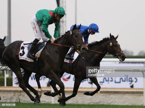 Jockey Christophe Soumillon rides Vazirabad to win the Dubai Gold Cup at the Dubai World Cup in the Meydan Racecourse on March 25 2017 in Dubai / AFP...
