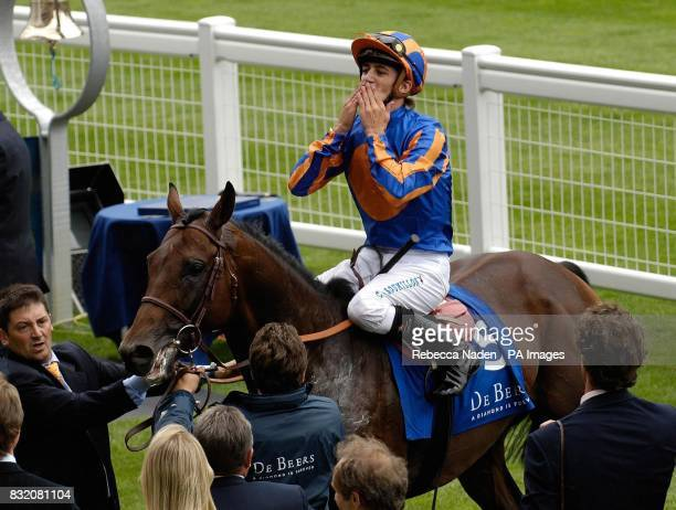 Jockey Christophe Soumillon takes the applause after Hurricane Run won The King George VI and Queen Elizabeth Diamond Stakes at Ascot racecourse