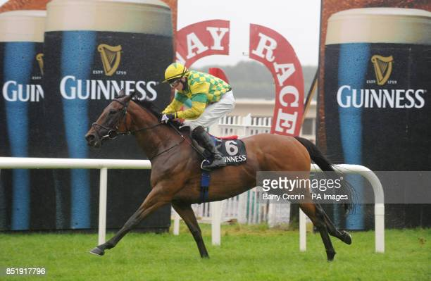 Jockey Conor King rides Maundy Money to victory in the Guinness Time Handicap during day four of the 2013 Galway Summer Festival at Galway Racecourse...