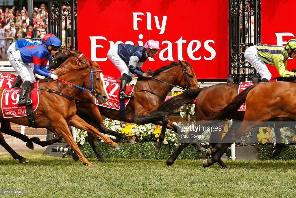 Jockey Corey Brown rides Rekindling past the winning post in the first lap of race 7, the Emirates Melbourne Cup, during Melbourne Cup Day at Flemington Racecourse on November 7, 2017 in Melbourne, Australia. Brown went on to win his second Melbourne Cup with the Lloyd Williams-owned Rekindling.