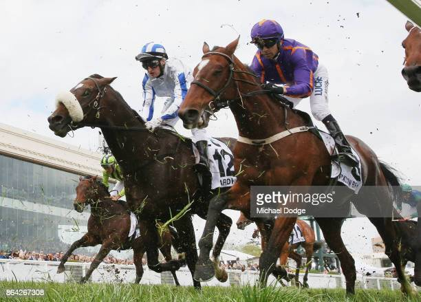 Jockey Craig Newitt finishes unplaced on Hardham next to Wicklow Brave in Race 8 Caulfield Cup during Melbourne Racing on Caulfield Cup Day at...