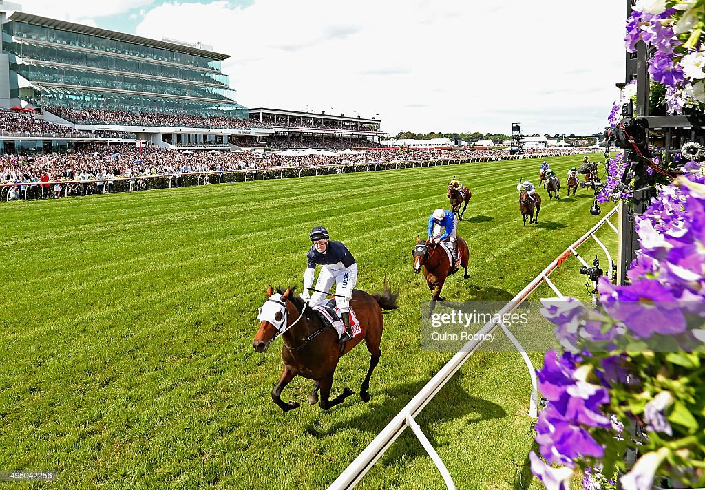 Jockey Craig Newitt riding Tarzino crosses the line to win race 7 The AAMI Victorian Derby on Derby Day at Flemington Racecourse on October 31 2015...