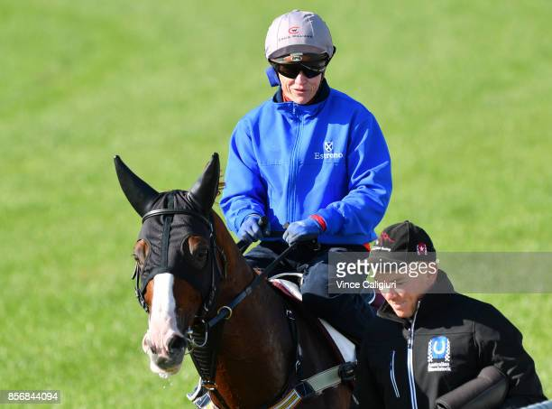 Jockey Craig Williams and strapper Matt Scown walk Admire Deus after a trackwork session at Werribee Racecourse on October 3 2017 in Melbourne...