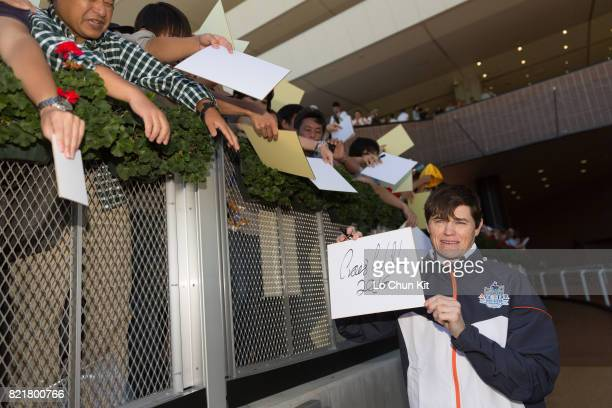 Jockey Craig Williams gives his autograph to Japanese racing fans at Sapporo Racecourse on August 27 2016 in Sapporo Hokkaido Japan