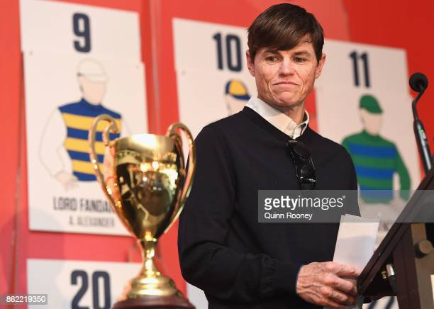 Jockey Craig Williams looks at the Caulfield Cup during the Caulfield Cup Barrier Draw at Caulfield Racecourse on October 17 2017 in Melbourne...