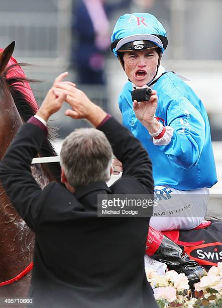 Jockey Craig Williams riding Berisha fims the crowd while returning to scale after winning race 2 the Swisse Wellness Trophy on Oaks Day at...