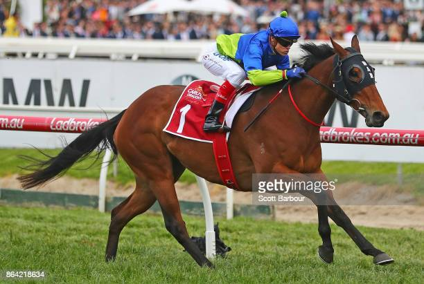 Jockey Craig Williams riding Fuhryk wins race 10 the Carlton Draught Alinghi Stakes during Caulfield Cup Day at Caulfield Racecourse on October 21...