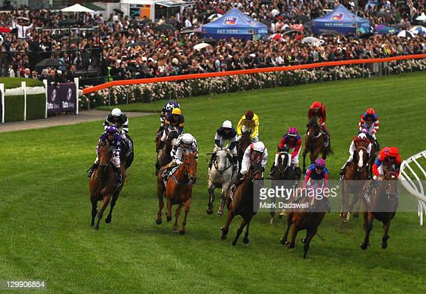 Jockey Craig Williams riding Pinker Pinker wins the Tatts Cox Plate during Cox Plate Day at Moonee Valley Racecourse on October 22 2011 in Melbourne...