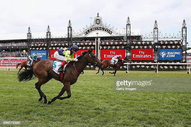 Jockey Craig Williams riding Power Trip beats Dale Smith riding Flying Artie to win race 1 the RacingCom Maribyrnong Plate on Stakes Day at...