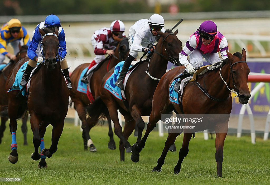 Jockey Dale Smith (R) riding Loveyamadly wins race five the City of Glen Eira Handicap during Australia Day Races at Caulfield Racecourse on January 26, 2013 in Melbourne, Australia.
