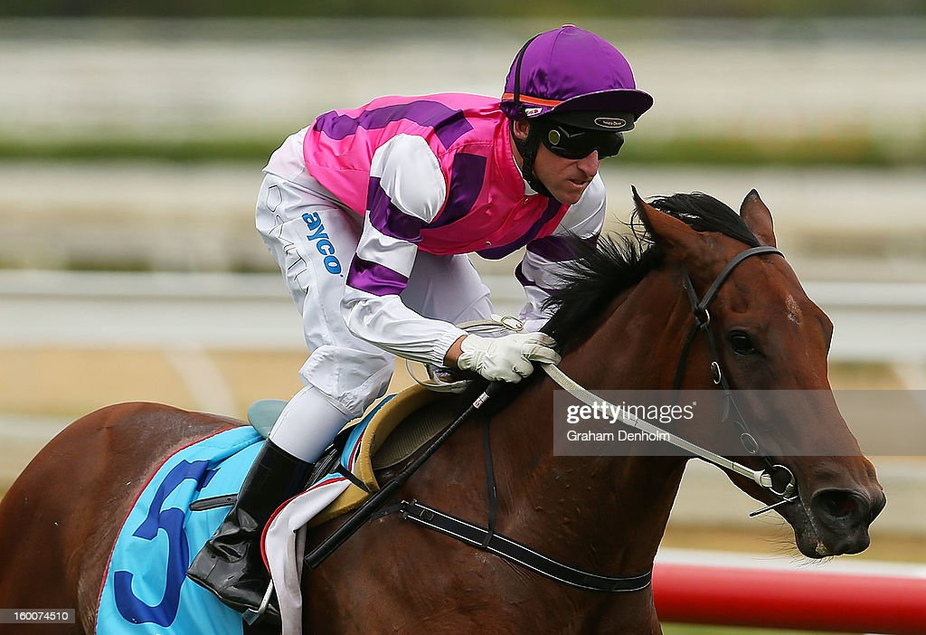 Jockey Dale Smith riding Loveyamadly wins race five the City of Glen Eira Handicap during Australia Day Races at Caulfield Racecourse on January 26, 2013 in Melbourne, Australia.