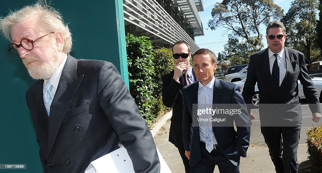 Jockey <a gi-track='captionPersonalityLinkClicked' href=/galleries/search?phrase=Damien+Oliver&family=editorial&specificpeople=210504 ng-click='$event.stopPropagation()'>Damien Oliver</a> (C) arrives at Racing Victoria headquarters ahead of the stewards inquiry into alleged race betting on November 20, 2012 in Melbourne, Australia.