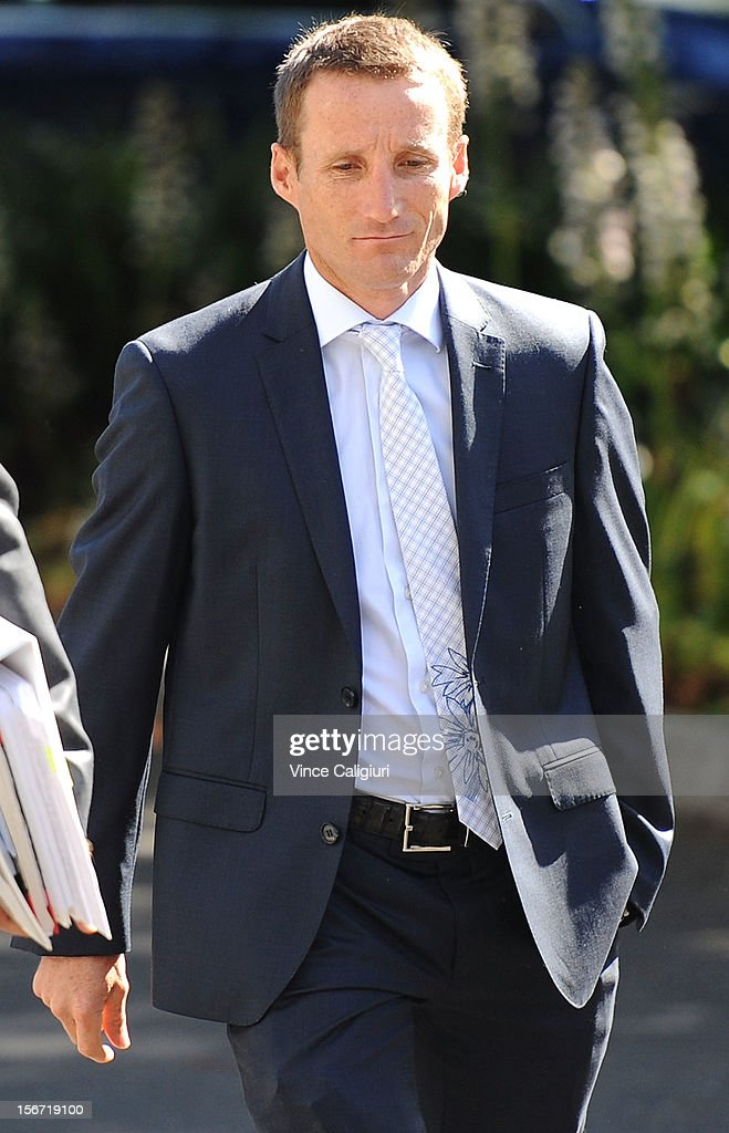 Jockey <a gi-track='captionPersonalityLinkClicked' href=/galleries/search?phrase=Damien+Oliver&family=editorial&specificpeople=210504 ng-click='$event.stopPropagation()'>Damien Oliver</a> arrives at Racing Victoria headquarters ahead of the stewards inquiry into alleged race betting on November 20, 2012 in Melbourne, Australia.