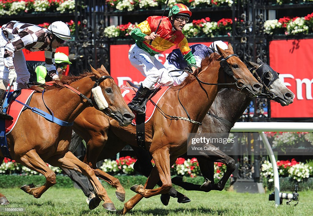 Jockey <a gi-track='captionPersonalityLinkClicked' href=/galleries/search?phrase=Damien+Oliver&family=editorial&specificpeople=210504 ng-click='$event.stopPropagation()'>Damien Oliver</a> celebrates on Happy Trails to win the Emirates Stakes during 2012 Emirates Stakes Day at Flemington Racecourse on November 10, 2012 in Melbourne, Australia.