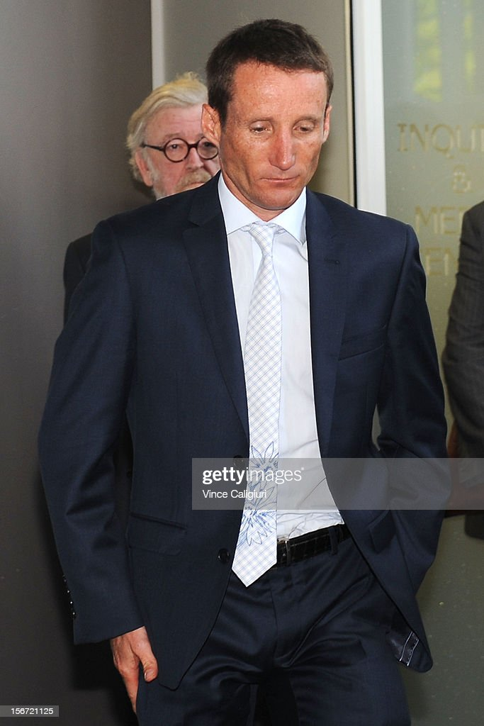 Jockey <a gi-track='captionPersonalityLinkClicked' href=/galleries/search?phrase=Damien+Oliver&family=editorial&specificpeople=210504 ng-click='$event.stopPropagation()'>Damien Oliver</a> leaves the stewards inquiry into alleged race betting on November 20, 2012 in Melbourne, Australia.
