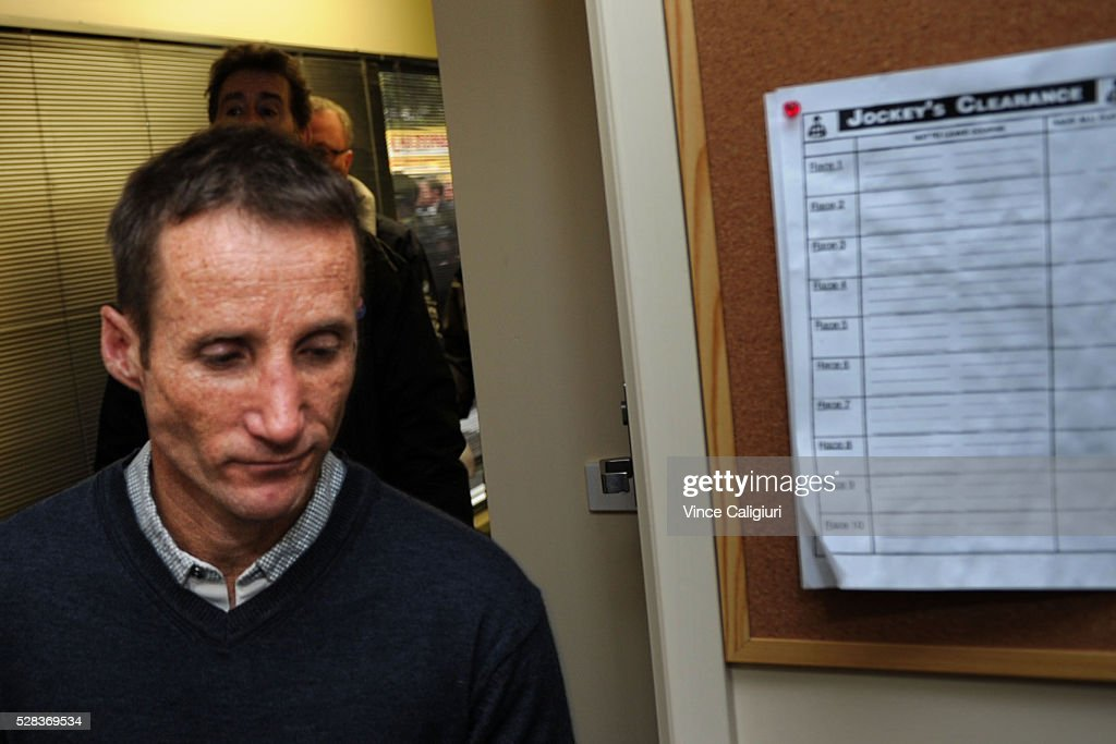 Jockey <a gi-track='captionPersonalityLinkClicked' href=/galleries/search?phrase=Damien+Oliver&family=editorial&specificpeople=210504 ng-click='$event.stopPropagation()'>Damien Oliver</a> leaves the stewards room after he was suspended for a month after failing an on course breath test on Grand Annual Day at Warrnambool Race Club on May 5, 2016 in Warrnambool, Australia.