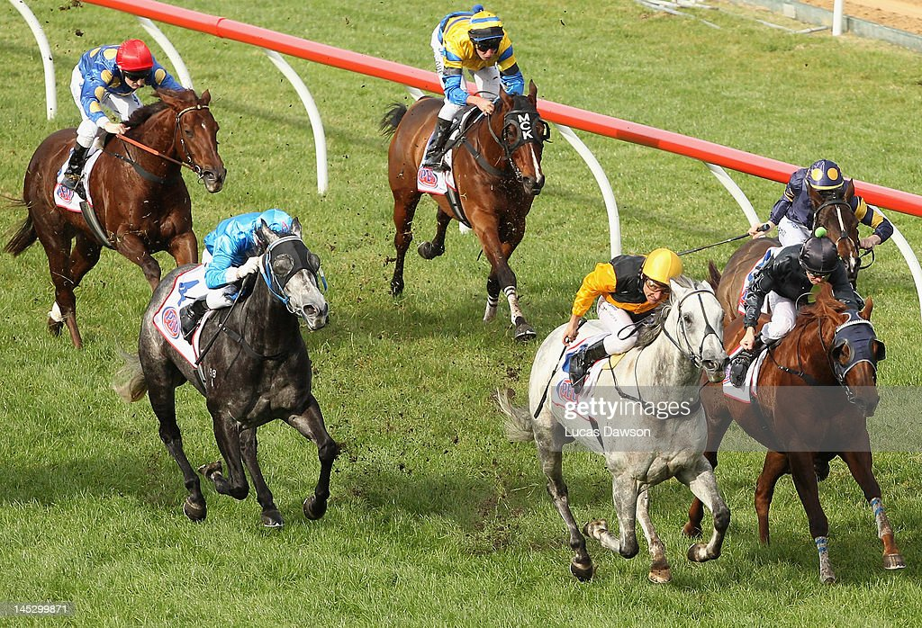 Jockey <a gi-track='captionPersonalityLinkClicked' href=/galleries/search?phrase=Damien+Oliver&family=editorial&specificpeople=210504 ng-click='$event.stopPropagation()'>Damien Oliver</a> riding Alpha Proxima wins Race 4 the Pfd Food Services Handicap at Taralye Race Day at Caulfield Racecourse on May 26, 2012 in Melbourne, Australia.