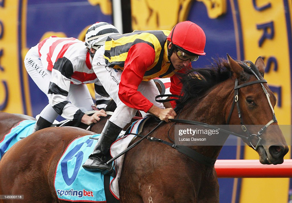 Jockey <a gi-track='captionPersonalityLinkClicked' href=/galleries/search?phrase=Damien+Oliver&family=editorial&specificpeople=210504 ng-click='$event.stopPropagation()'>Damien Oliver</a> riding Soft Sand wins Race 5 the Alh Group Plate at Taralye Race Day at Caulfield Racecourse on May 26, 2012 in Melbourne, Australia.