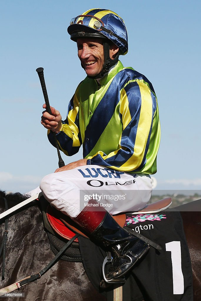 Jockey <a gi-track='captionPersonalityLinkClicked' href=/galleries/search?phrase=Damien+Oliver&family=editorial&specificpeople=210504 ng-click='$event.stopPropagation()'>Damien Oliver</a>, the most successfull jockey of the Carnival, returns to scale on Lucia Valentina after winning race 8 the Presto Matriarch Stakes on Stakes Day at Flemington Racecourse on November 7, 2015 in Melbourne, Australia.