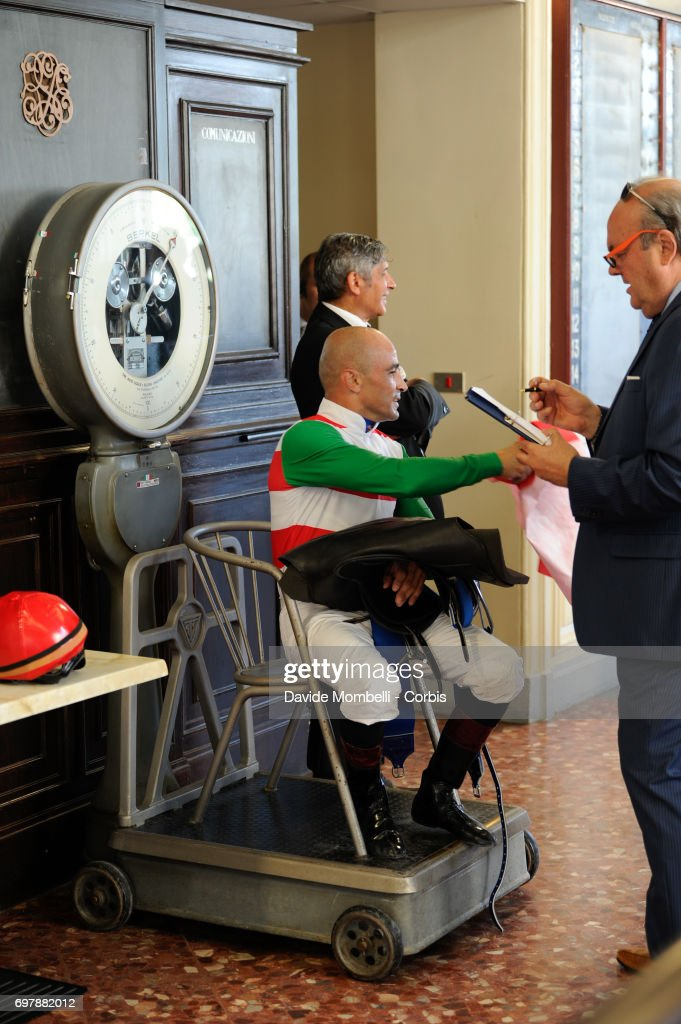 Jockey Dario Vargiu sits on the scales in the weighing room after winning with Full Drago in the Grand Prix in Milan on June 18, 2017 in Milan, Italy.