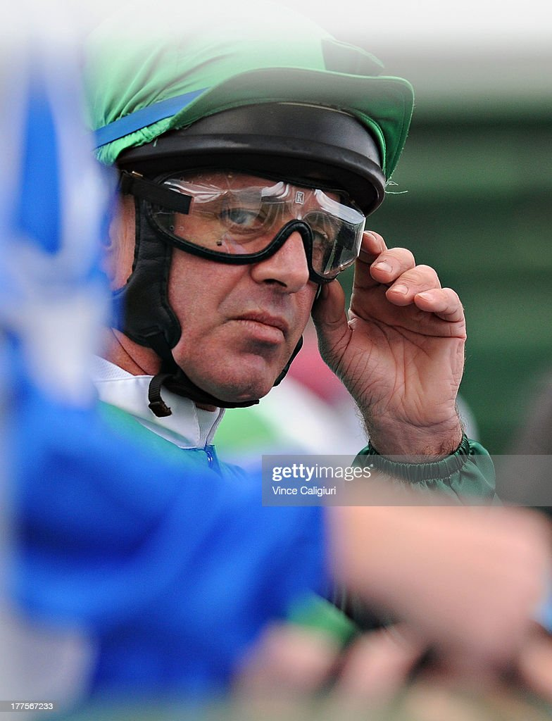Jockey Darren Gauci adjusts his goggles in the barriers during Melbourne Racing at Moonee Valley Racecourse on August 24, 2013 in Melbourne, Australia.