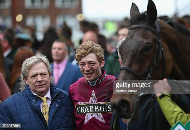 Jockey David Mullins poses in the winners enclosure alongside Mouse Morris the trainer of Rule The World winner of the Crabbie's Grand National...