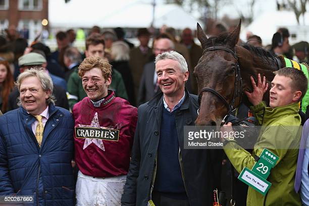 Jockey David Mullins poses in the winner's enclosure alongside trainer Mouse Morris and owner Michael O'Leary of Rule The World winner of the...