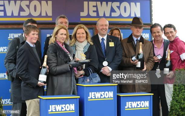 Jockey Davy Russell owner Michael O'Leary and trainer Willy Mullins celebrate victory in the Jewson Novices' Chase with Sir Des Champs on St...