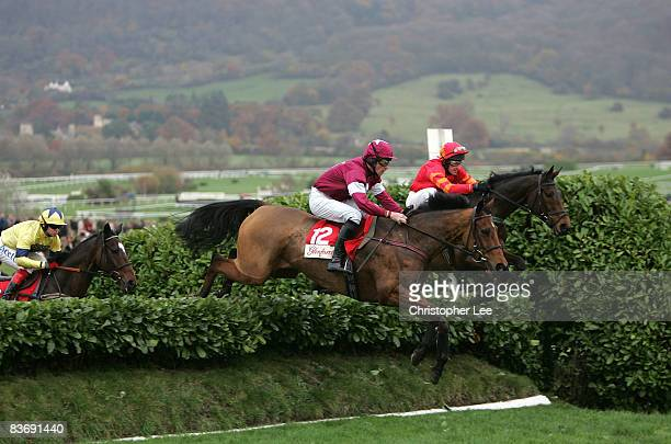 Jockey Davy Russell riding Dix Villez a hurdle to win The Glenfarclas Cross Country Steeple Chase at Cheltenham Racecourse on November 14 2008 in...