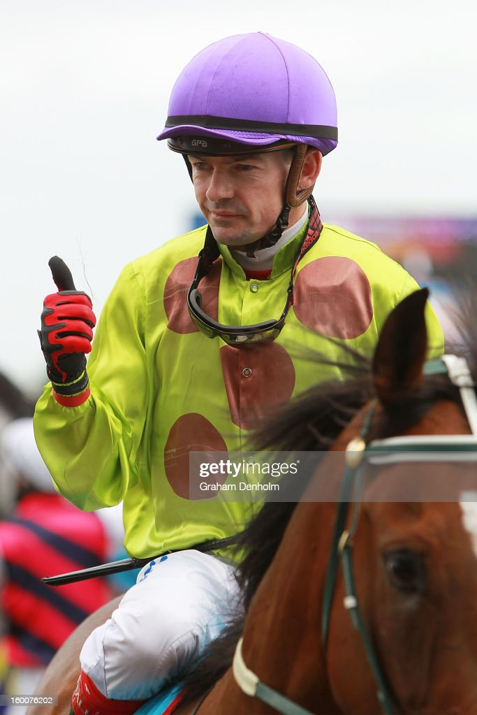 Jockey Dean Yendall gives the thumbs up after riding Le Remas to victory in race six the Swettenham Stud John Dillon Stakes during Australia Day Races at Caulfield Racecourse on January 26, 2013 in Melbourne, Australia.