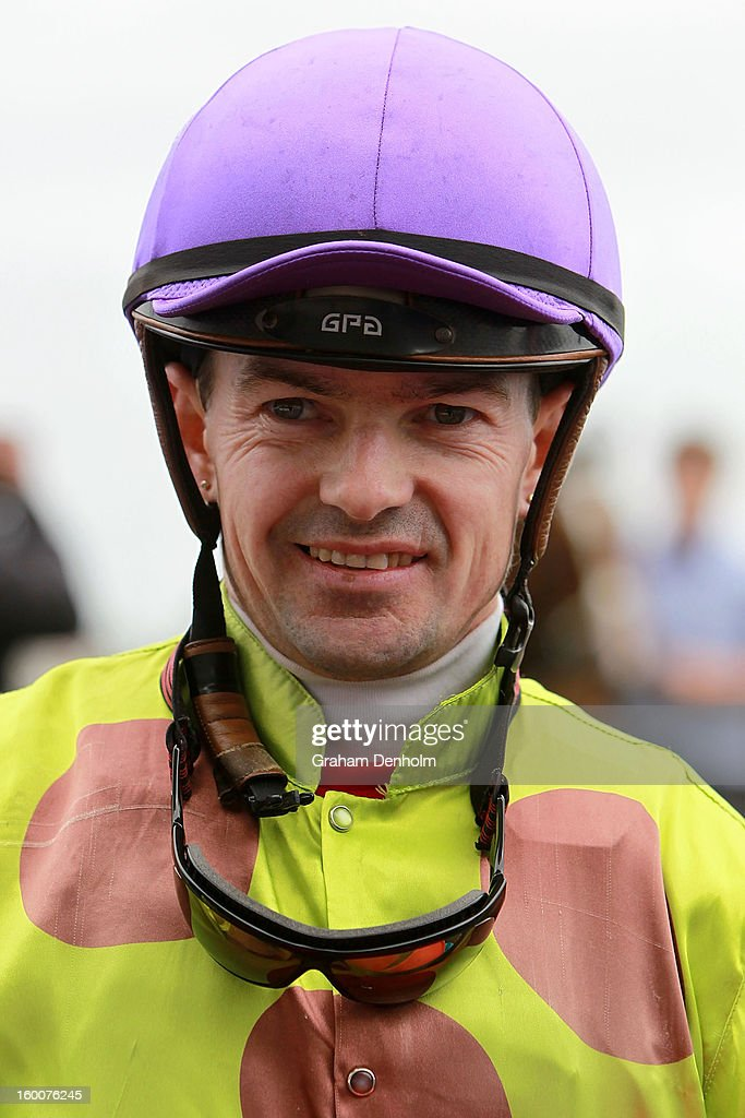 Jockey Dean Yendall smiles after riding Le Remas to victory in race six the Swettenham Stud John Dillon Stakes during Australia Day Races at Caulfield Racecourse on January 26, 2013 in Melbourne, Australia.