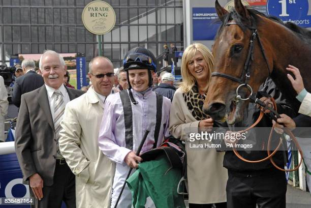 Jockey Declan McDonogh celebrates with connections of Utmost Respect after their victory in the Weatherbys Ireland Greenlands Stakes during the...