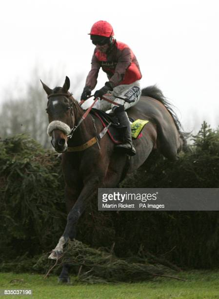 Jockey Dougie Costello on Brooklyn Brownie jumps the last fence in the totesuper7 Grand Sefton Handicap Steeple Chase