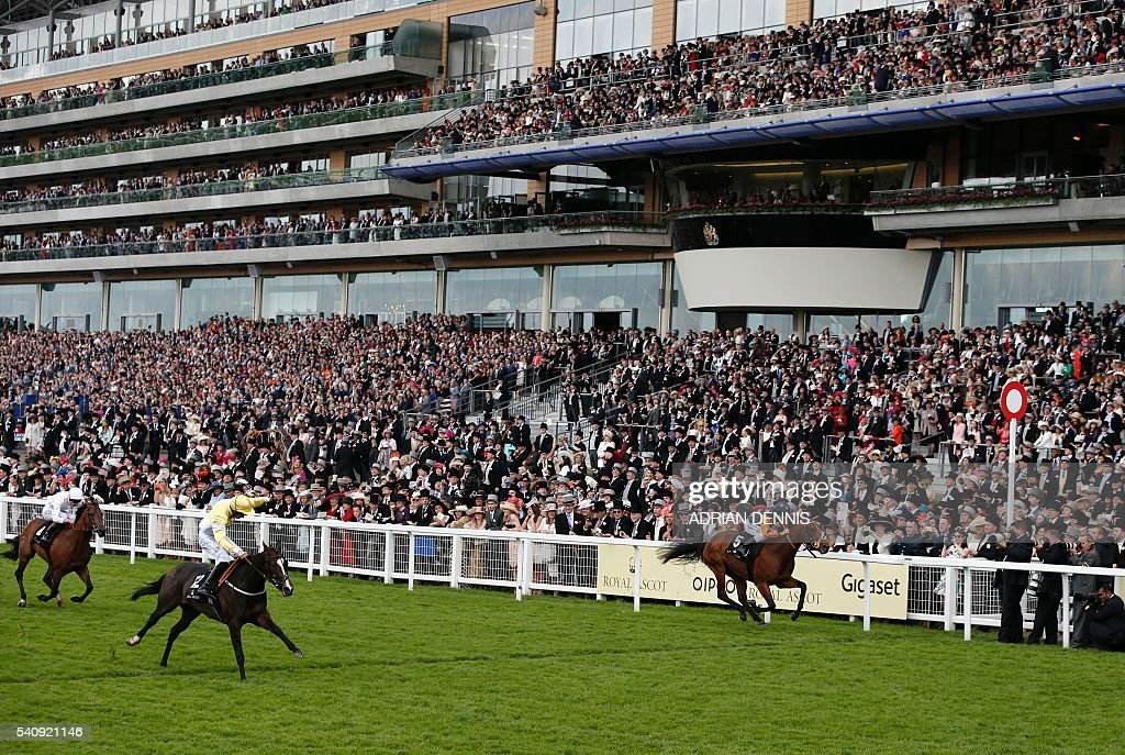 Jockey Dougie Costello rides Quiet Reflection past the finish line to win The Commonwealth Cup group 1 race during day four at Royal Ascot horse...